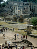 Tourists Walk Through Rome's Ancient Forum with Palatine Hill Behind