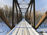 Old Steel Bridge Covered in Snow in the White Mountains in New Hampshire