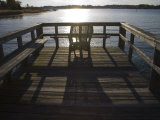 Sunset Sparkles and Casts Shadows on a Peaceful Pier