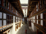 Monk Walks Through the Fortress-Style Architecture of a Dzong