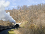 Old Fashioned Steam Train Heads into a Tunnel
