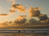 Two Surfers Enter the Pacific Ocean as the Sun Sets in Hawaii