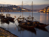 Wine Barrels on Boats in Oporto at Dusk