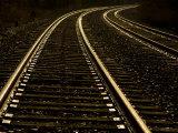 Gleaming Tracks Reflect Sundown Along the Railroad