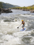 Man on a Stand Up Paddle Board Runs Rapids in the Potomac River