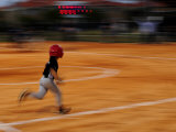 Boy Runs During a Baseball Game at Night
