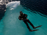 Diver Floating in the Icy Waters of Baffin Island