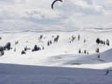 Person Snow Kiting on Skis