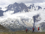Hikers on a Ridge Line with Snow Covered Peaks in the Background