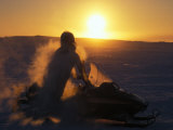 Inuit Hunter on a Snowmobile at -40 Degrees Celsius  at Sunset