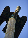 Carved Wooden Bird at the Top of a Totem Pole in Ketchikan  Alaska