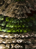 Rows of Green and Clear Glass Bottles Create a Structure