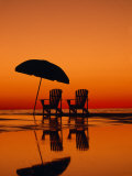 Picturesque Scene with Two Chairs and an Umbrella on the Beach