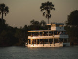 Tour Boat Cruises the Zambezi River  Looking for Wildlife