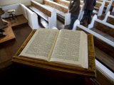Open Bible and Tourists in a Small Local Church