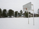 Basketball Court in a Vacant Lot Covered in Heavy Snow