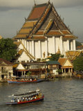 Tourists Arrive in Boats at a Riverside Temple in Bangkok