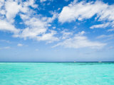 Cloud-Filled Sky and Clear Blue Waters of Ambergris Cay