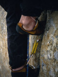 Close Up of a Team Member's Feet Wedged in a Crack in the Granite