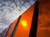 Bright Orange Sound Barrier by a Freeway