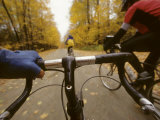 Bikers Ride Down a Country Road in the Fall