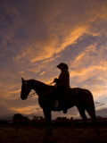 Silhouetted Cowboy Actor on Horseback on an Old Western Movie Set