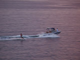 Water-Skiier Skiing Behind a Motorboat at Sunset