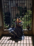 Gypsy Woman Sits on Ledge of Window Overlooking the Alhambra