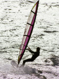 Windsurfer Sailing across the Water