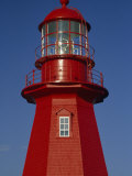 Brightly Painted  Red Lighthouse in Quebec