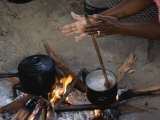 Woman Prefers to Cook the Traditional Way  over a Wood Fire
