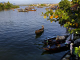 Fishing Boats Ply the Thu Bon River Near the Market at Hoi An