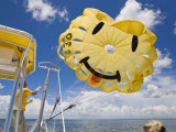 Parasail Operator Prepares Parachute for the Next Set of Tourists