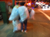 Woman Collecting Recyclables on a San Francisco City Street