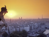 Gargoyle on Notre Dame Cathedral and Paris at Sunset