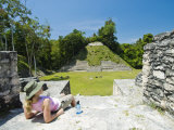 Young Woman Relazing at the Mayan Ruins at Caracol  Belize