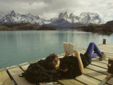 Woman Relaxes on a Dock While Reading a Book Papier Photo par Skip Brown