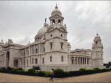 Man Walking Past Lord CurzonS Massive Victoria Memorial