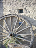 Texas  Western Themed Brewster County Wagon Wheel Against White Washed Adobe Wall