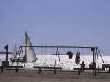 Sailboat and Kids on a Swing at a Playground at Sept-Iles  Quebec