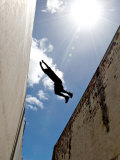 Parkour Practitioner Jumps a Building Gap in Adelaide  Sa