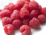 Ripe Red Raspberries on a Plate