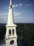 Man Paints the Steeple of a Vermont Church
