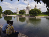 Two Young Men Look across Water at Lord CurzonS Victoria Memorial