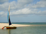 Boy Pushes a Dhow Seaward Along Banguerra Island in Mozambique