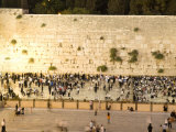 Jewish Men and Women Pray at the Western Wall at Night