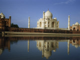 At Sunrise the Taj Mahal's Reflection Shimmers in Tranquil River