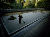 Men Rake the Famous Rock Garden at the Zen Ryoanji Temple