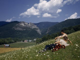 Men in Flower-Carpeted Hillside Meadow Look Toward Seneca Rocks