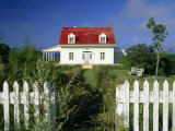 Cozy Cottage with a Red Roof and White Picket Fence